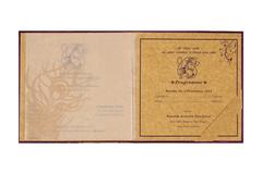 Sikh Wedding Satin Card in Purple and Golden with Peacock