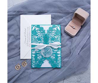 Beach wedding designer laser cut invitation in teal shimmer -