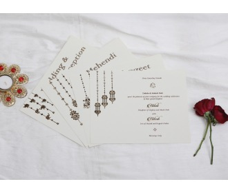 Beautiful hangings with Ganesha Beige wedding invite