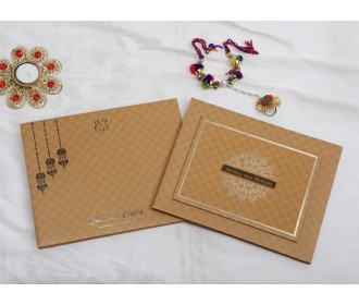 Beautiful hangings with Ganesha Beige wedding invite -