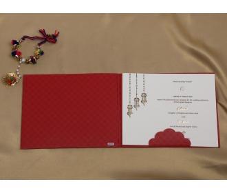 Beautiful hangings with Ganesha Red wedding invite