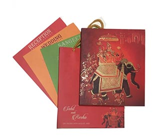 Beautiful Royal Indian wedding invitation card in rich red colour