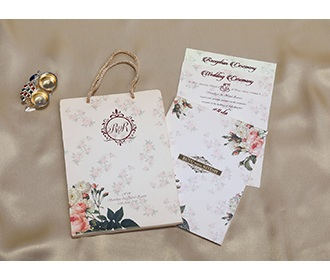 Beige Floral Indian wedding invitation in carry bag style