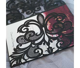 Black colour gate fold laser cut wedding invite with a golden bowknot