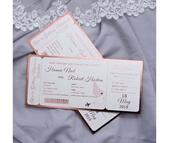 Boarding pass destination wedding invitation in metallic pink -