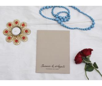 Brown colored laser cut wedding invite