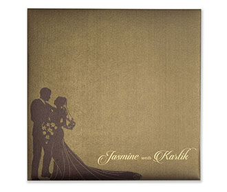 Brown colour Wedding Invite in cardboard with a cut out of a couple