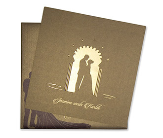 Brown colour Wedding Invite in cardboard with a cut out of a couple -