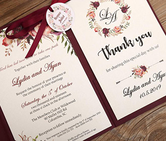 Burgundy color wedding invitation in floral theme