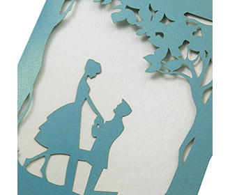 Card in Blue with a marriage proposal scene in laser cut design