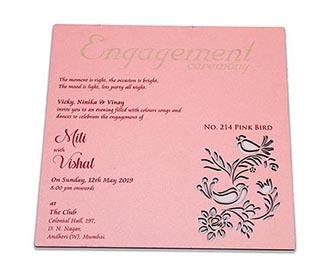 Cardboard wedding invite in pink color with laser cut birds