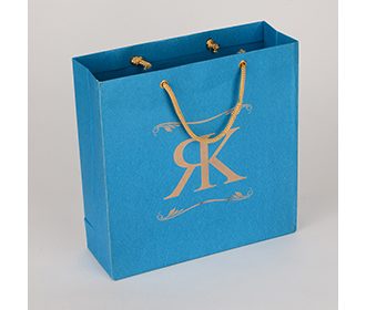 Carry bag in blue color with name initials