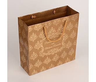 Carry bags in copper brown color with traditional indian motifs