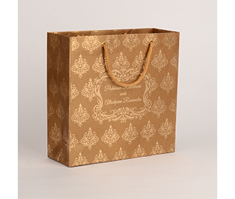 Carry bags in copper brown color with traditional indian motifs -
