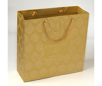 Carry bags in golden color with traditional indian motifs