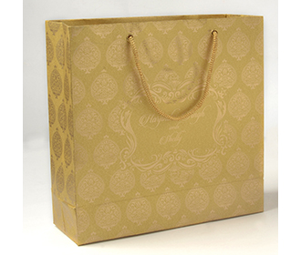 Carry bags in golden color with traditional indian motifs -
