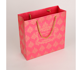 Carry bags in pink color with traditional indian motifs