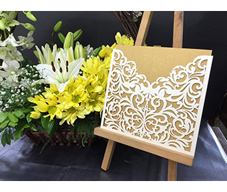 Indian wedding card wiith laser cut floral pocket in Ivory