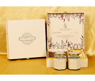 Cream colour Indian wedding box invite with designer inserts & sweet jars -