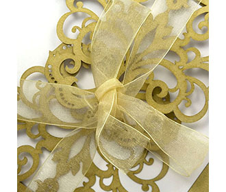 Designer floral laser cut invite in golden colour with a ribbon