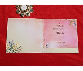 Designer floral wedding invitation card in cream colour