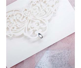 Elegant laser cut wedding invite with silver rhinestone