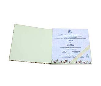 Elegant peacock theme Indian wedding card in blue