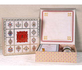 Ethnic Indian wedding invitation box with sweet jars -