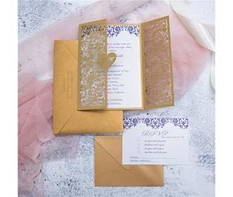 Fairy vine laser cut wedding invite with monogram on heart