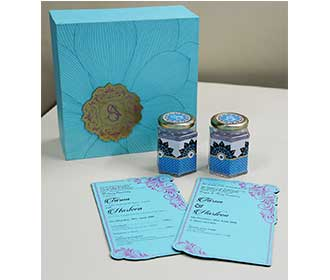 Floral theme wedding box invite in sky blue color with sweet jars -