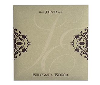 Four fold laser cut wedding invitation in light golden colour