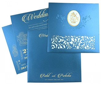 Ganesha theme Hindu wedding card in blue with laser cut floral patterns -