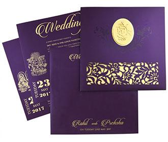 Ganesha theme Hindu wedding card in purple with laser cut floral patterns -