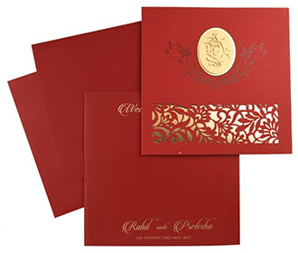 Ganesha theme Hindu wedding card in red with laser cut floral patterns -