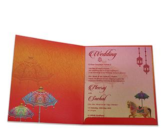 Ganesha theme Indian wedding card in orange colour
