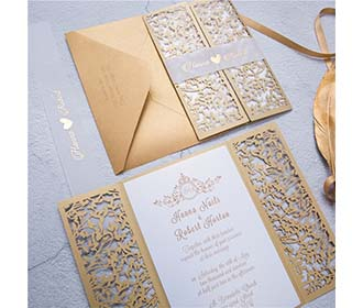 Gate fold wedding invitation in golden colour with a mesh of leaves