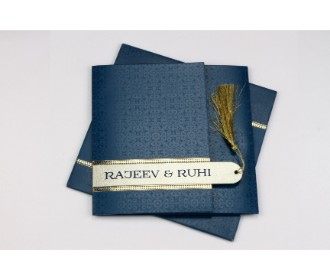 Gatefold style midnight blue and gold card with a tassel opening