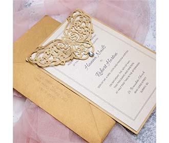 Golden colour laser cut reception & wedding invitation