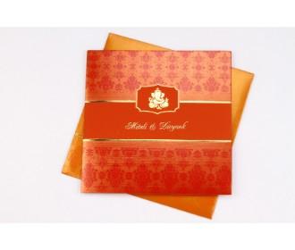 Hindu wedding card in orange and red with Ganesha design