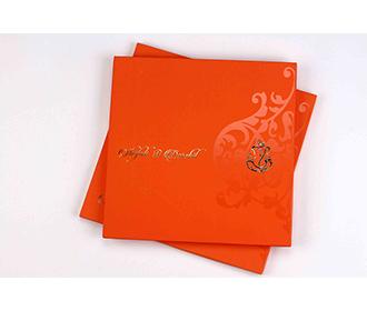 Hindu wedding invitation card in bright orange colour