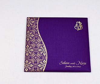 Hindu wedding invite in purple with golden paisley