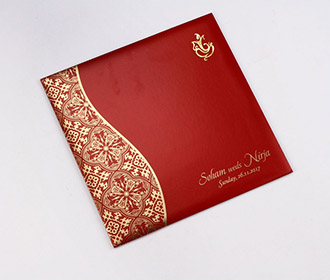 Hindu wedding invite in red with golden paisley