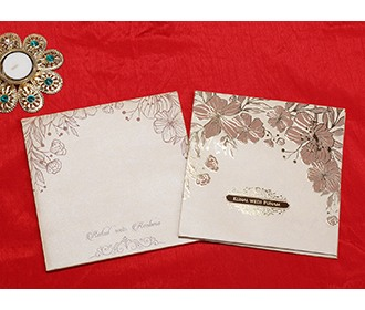 Indian wedding card in beige with embossed floral designs -