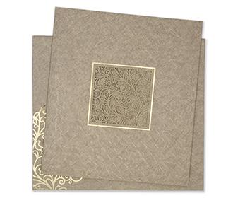 Indian wedding card in light brown motifs and laser cut design