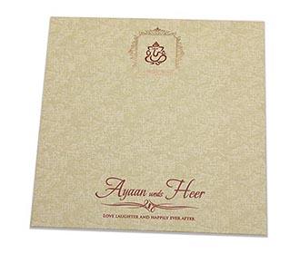 Indian wedding card with semi circular geometric patterns in brown