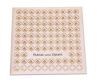 Indian wedding invitation in laser cut geometric pattern in cream colour -