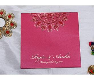 Indian wedding invitation in pink with designer motifs