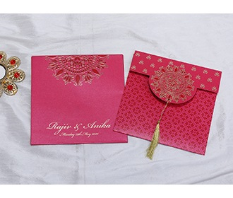 Indian wedding invitation in pink with designer motifs -