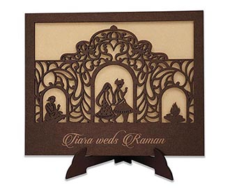 Invitation in laser cut photo frame style with a saat phera design -