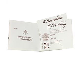 Ivory colour Indian wedding invite with embossed flowers